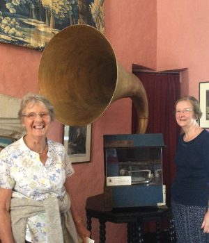 Trip to Knole & Ightham Mote July 2017. Brenda Tumilty & Cynthia Millward dwarfed by the horn of a 1929 gramophone in Eddie Sackville-West's apartments at Knole.